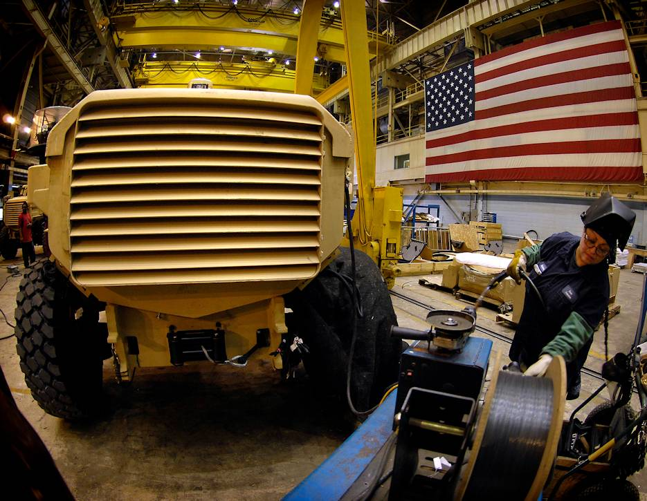 A worker at Force Protection Industries Inc. makes a Cougar H 4 X 4 MRAP vehicle at the factory in Ladson, SC on January 18, 2008. Production began in 2001 and increased significantly in 2006, as it became increasingly clear that the MRAP's V-shaped hull, which deflects underbelly blasts, was providing better protection for troops from improvised explosive devices. (U.S. Defense Department photo by Cherie A. Thurlby)