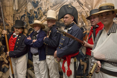 Photograph of living history interpreters in vintage-style revenue cutter uniforms during the War of 1812. (U.S. Coast Guard photo by Petty Officer 2nd Class Walter Shinn)