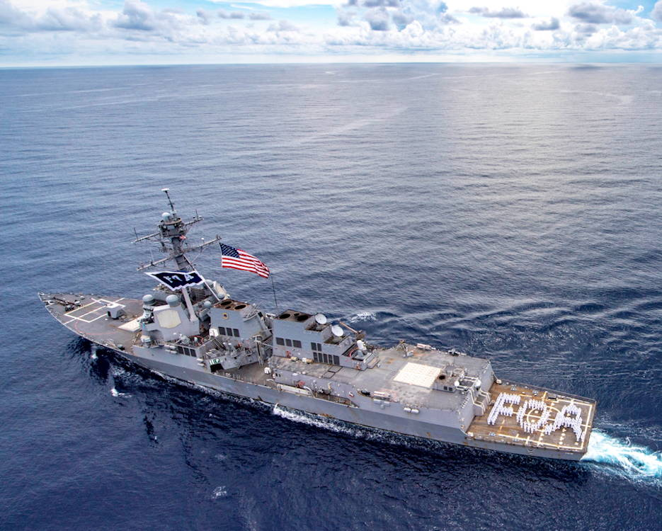 "October 2, 2019 - The guided-missile destroyer USS Wayne E. Meyer (DDG 108) celebrates the 10th anniversary of the ship's commissioning, while transiting the South China Sea. Named after Rear Adm. Wayne E. Meyer, the ""Father of Aegis, (FOA)"" the crew stands in formation in his namesake. (Image created by USA Patriotism! from U.S. Navy photo by Mass Communication Specialist 2nd Class Rawad Madanat)"