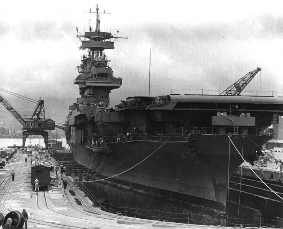 USS Yorktown (CV-5) in Dry Dock 1 at the Pearl Harbor Navy Yard, 29 May 1942, receiving urgent repairs for damage received in the Battle of Coral Sea. She left Pearl Harbor the next day to participate in the Battle of Midway. (U.S. Navy courtesy photo)