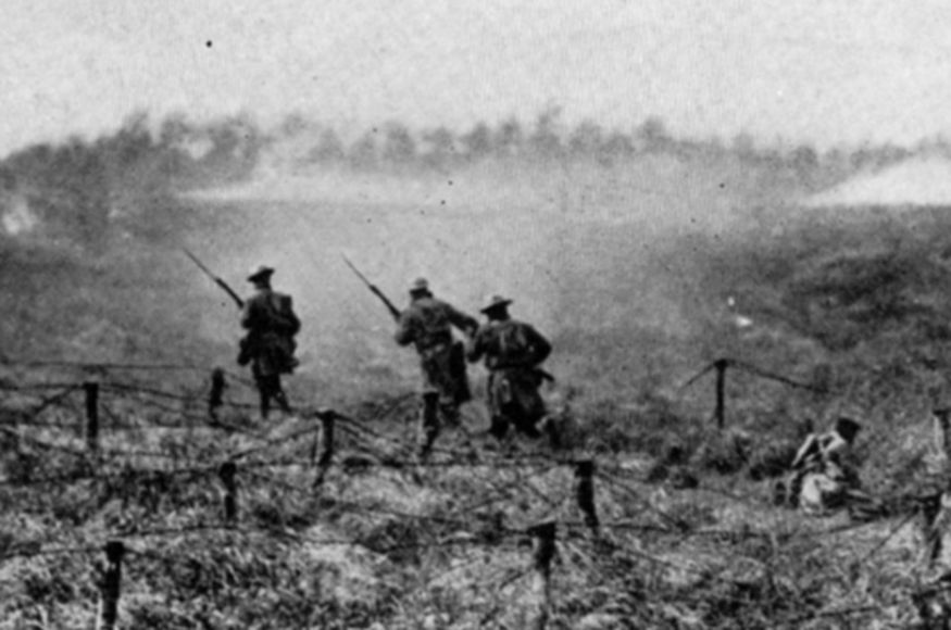 New York National Guard Soldiers of the 27th Division's 107th Regiment training for the planned attack on the Hindenburg Line during September 1918. In this photograph the Soldiers practice moving through barbed wire obstacles. When the actual attack kicked off on September 29, 1918 the 107th Infantry lost 1,000 Soldiers wounded and killed out of 1,662. (Courtesy New York State Military Museum)
