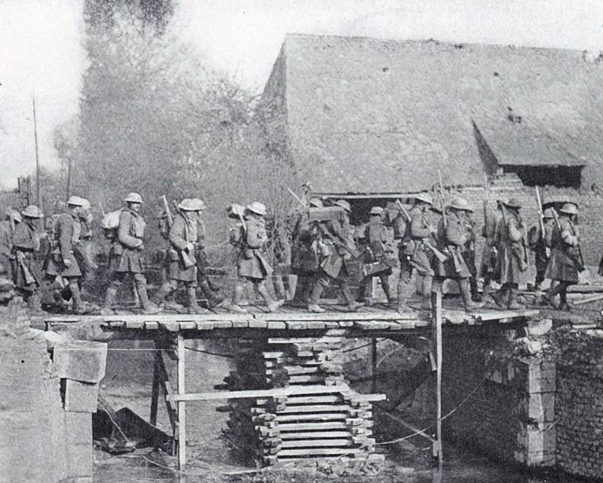 New York National Guard Soldiers of the 108th Infantry Regiment of the 27th Division cross a bridge over the LeSelle River on their way to St. Souplet, France during the Hindenburg Line campaign in the fall of 1918. The bridge was built by the Soldiers of the 102nd Engineer Battalion. (Courtesy New York State Military Museum)