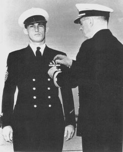 Ray Evans receiving his Navy Cross Medal for action seen at Point Cruz. Evans had already received a battlefield advancement and later received an officer's commission. Coast Guard Collection.