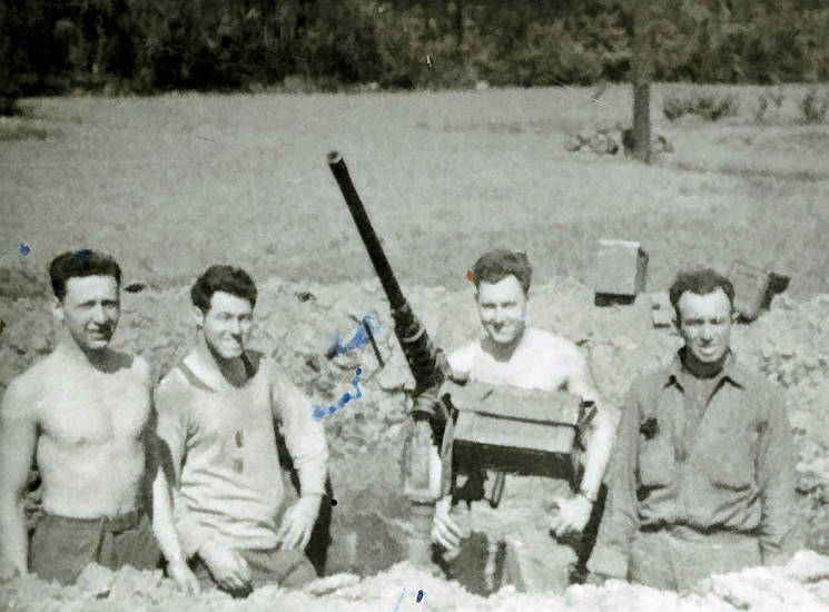 Army PFC Charlie Brown, then 19, a native of Delavan, New York, stands behind a 50 caliber M2 anti-aircraft gun in a field outside Teilleul, France on October 8, 1944 with other members of Headquarters Battery of the 258th Field Artillery. On the back of the photo, Brown, who is now 93, noted that the unit was bombed and straffed here. Brown still has a knife that was hit by shrapnel that night. (Courtesy Mr. Charles Brown)