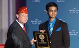 2014 American Legion National Oratorical Champion Ashwath Kumar, a senior at David H. Hickman High School in Columbia, MO, receiving his plaque from the American Legion.