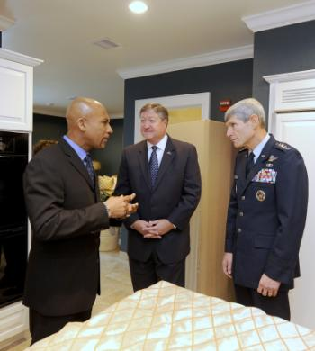 Celebrity talk show host Montel Williams talks with Secretary of the Air Force Michael Donley and Air Force Chief of Staff Gen. Norton Schwartz at Dover Air Force Base, Del., on Nov. 10, 2010. The three helped dedicate the new Fisher House for Families of the Fallen during a ceremony there. U.S. Air Force photo by Scott M. Ash