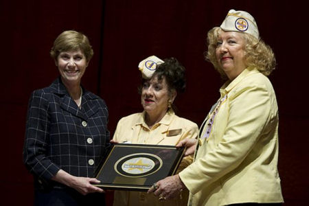Deborah Mullen (left) is presented the Gold Star Wives of America Appreciation Award by Ruth Miller, board chair, and Kit Frazer, president, Gold Star Wives, at the organization's annual Congressional Reception at the U.S. Captiol Visitors Center May 27. Mullen and her husband, Adm. Mike Mullen, chairman of the Joint Chiefs of Staff, were both honored in recognition of their devotion to families of the fallen and wounded warriors. WASHINGTON (Army News Service, June 1, 2010) -- Back during World War II, a small group of women met in a living room to lend support to those whose husbands were killed in the line of duty. Now 65 years later, that small group has become the Gold Star Wives of America, standing 10,000-strong with 60 chapters across America. Photo by Mass Communication Specialist Chad J. McNeeley