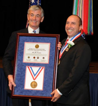Secretary of the Army John M. McHugh awards Homes for Our Troops founder John Gonsalves the 2010 Zachary and Elizabeth Fisher Distinguished Civilian Humanitarian Award for his commitment to build specially-adapted homes for wounded warriors at no cost to them.