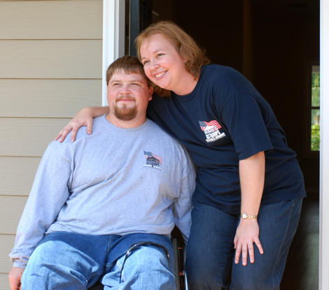 Retired Cpl. Joshua Lindsey and his fianc�e, Tracey Froebel, pause for some pictures before entering their new house north of Atlanta, June 26. Lindsey was severely injured after he was shot while on a patrol with his battalion in Iraq, in February of 2005. Homes for Our Troops, a non-profit organization, provided the home at no cost to Lindsey thanks to the work and materials donated from corporate sponsors, tradesmen, foundation grants and other local volunteers. Photo by Army Sgt. Jason Thompson