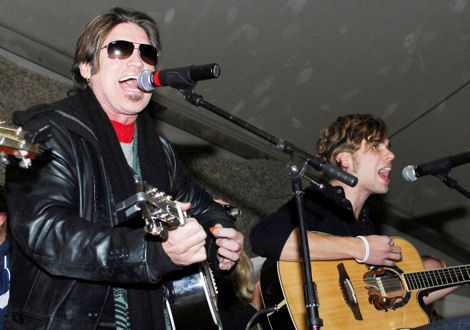 Billy Ray Cyrus, singer/actor, entertains the Airmen, Soldiers, Sailors and Marines at Bagram Airfield during a United Service Organization tour Dec. 15, 2009.