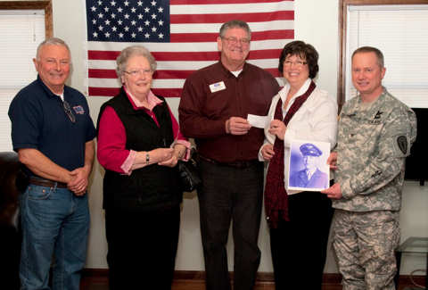 Doug Warnecke, executive director of the Indiana United Service Organization, Dorothy Zumhingst, wife of Lt. Col. Herbert H. C. Zumhingst, Duane Straw, president and CEO of the Indiana USO, Diane Scott, daughter of Lt. Col. Herbert H. C. Zumhingst, and Col. Todd Townsend, garrison commander of Camp Atterbury Joint Maneuver Training Center, Ind. gather for a photo during a presentation of a donation to the USO at Camp Atterbury January 25, 2011. The donation was in honor of the late retired Lt. Col. Herbert H. C. Zumhingst, a Seymour, Ind. native, who served in the U.S. Army Air Corps and U.S. Air Force at Bakalar Air Force Base in Columbus, Ind. Photo by Army Sgt. David Bruce