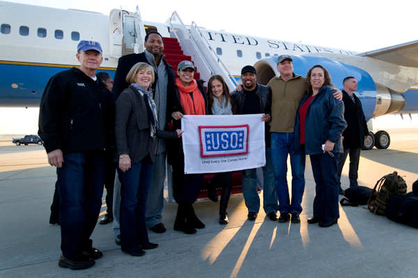 U.S. Army Gen. Martin E. Dempsey, chairman of the Joint Chiefs of Staff; Deanie Dempsey, the chairman's wife; Robert Horry; Jordan Sparks; Minka Kelly; Nephew Tommy; U.S. Marine Corps Sgt. Maj. Bryan Battaglia, the chairman's senior enlisted advisor; and his wife, Lisa, start their USO tour with a group photo on Andrews Air Force Base, Md., Dec. 13, 2011. DOD photo by D. Myles Cullen