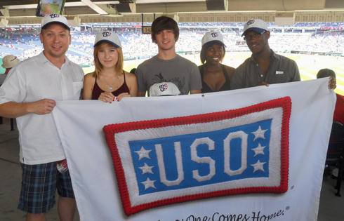 Kelsie Vick, second from left, poses with her friends, Josh Braden, Mimi Nsanzimana, and Kyle Thornhill before the start of the Washington Nationals-New York Mets baseball game at Nationals Stadium in Washington, D.C., July 4, 2010. Kelsie has relocated 10 times with her Army family. USO photo