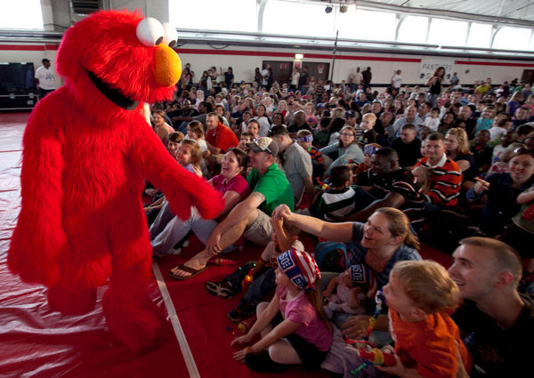 Elmo greets some of his fans in the audience during a performance of the Sesame Street/USO Experience for Military Families at U.S. Army Kaiserslautern Sept. 20, 2009. The Sesame Street tour also stopped in Mannheim, Heidelberg and other locations throughout Europe. The free show was designed to educate military families about how to help children cope with the challenges of deployment.