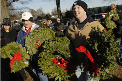 Volunteers prepare to lay wreaths on graves at Arlington National Cemetery in Arlington, Va., Dec. 12, 2009. About 6,000 volunteers placed more than 16,000 wreaths in honor of the nation's fallen heroes.