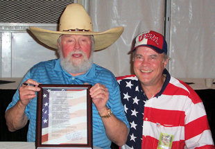David Bancroft, founder of USA Patriotism!, presenting Charlie Daniels with a signed copy of his poem, Patriot Charlie Daniels. (September 1, 2007)