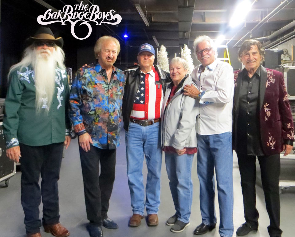 David Bancroft, USA Patriotism! Founder/Owner, and his wife, Mary, (center) enjoy a visit with Country Music Legends and Hall of Fame inductees ... The Oak Ridge Boys (L-R) William Lee Golden, Duane Allen, Joe Bonsall and Richard Sterban ... shortly before their uplifiting performance for their anxious patriotic audience in Branson, Missouri at the Mansion Theatre during Veterans Week in November 2019. (Photo and Image by USA Patriotism!)