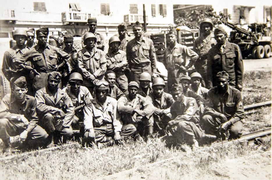 "U.S. Army Cpt. William Cline (crouching lower left corner), a 1941 Clemson College graduate, poses with his unit, part of the 758th Tank Battalion, in Genoa, Italy just after the war. The 758th was the only all-black tank battalion in Italy in WWII and served alongside the 92nd ""Buffalo"" Infantry Division. (Photo courtesy of Bill Cline Jr.)"