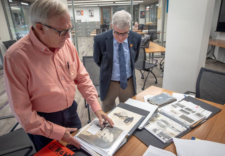 Bill Cline Jr. shows a collection of his father's mementos from WWII to Clemson University's Dean of Libraries Christopher Cox, August 25, 2019. Cline's father was U.S. Army Cpt. William Cline, a 1941 Clemson College graduate, who was a company commander for the 758th Tank Battalion, the only black tank battalion in Italy during WWII. (Photo by Ken Scar, U.S. Army Cadet Command)