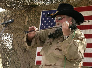 Charlie Daniels performs for soldiers of the Tennessee National Guard's 278th Regimental Combat Team at Forward Operating Base Cobra in Northeastern Iraq.