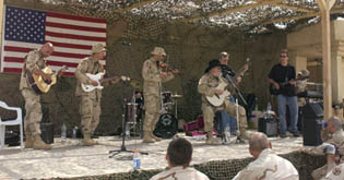 Soldiers from Tennessee's 278th Regimental Combat Team perform with the Charlie Daniels Band during a recent visit to Forward Operating Base Cobra, in Northeastern Iraq.