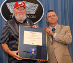 Charlie Daniels (left,) country/southern Rock Musician, receives the Office of the Secretary of Defense Medal for exceptional public service in support of armed troops from Michael L. Dominguez, principal deputy under secretary of defense for personnel and readiness, during a visit to the Pentagon June 25, 2007. Dominguez said Daniels has performed for the troops in more than 20 different installations in countries across the globe. Defense Dept. photo by Petty Officer Second Class Molly A. Burgess