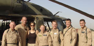 Chely in Iraq with troops in front of chopper