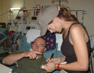 Chely visiting with a wounded troop