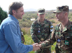 Darryl Worley shaking hands with a troop in Korean DMZ, October 2004.