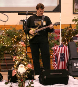 Eric Horner performing for troops in 2007