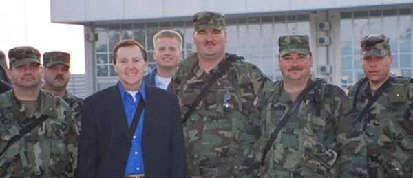 Fred Travalena with a group of soldiers (MPs) during USO a tour in 2005