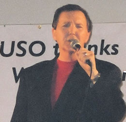 Fred Travalena performing during a USO tour