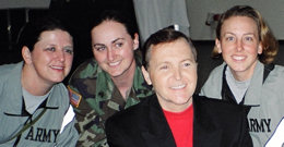 Fred with pretty soldiers in 2005 USO tour