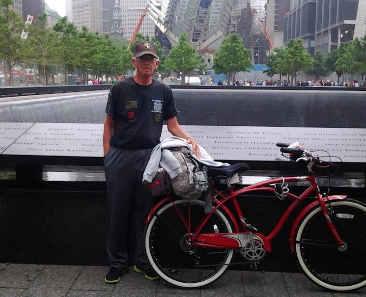 "Harry Conner poses with his bike, ""Old Huffy,"" at the National 9/11 Memorial at ""Ground Zero"" in New York, in the spring of 2014. Conner, who served in the United States Army from 1972 to 1980, has devoted his life to bicycling throughout the country in order to tell people the story of Sgt. 1st Class Alwyn Cashe, who died Nov. 8, 2005, as the result of injuries sustained Oct. 17, 2005, when the vehicle he was traveling in struck an IED. Cashe, covered in fuel, pulled his Soldiers from the burning vehicle, sustaining burns to more than 80 percent of his body. (Courtesy photo provided by Harry Conner)"