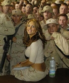 Leeann Tweeden with troops at the Baghdad airport during a December 2003 tour in Iraq.