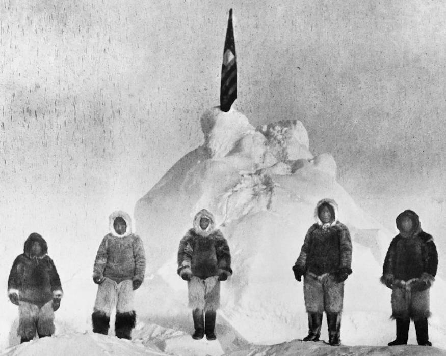 Matthew Henson (center) flanked by the expedition's four Eskimo dog drivers at the North Pole, 10:30 a.m., Eastern Standard Time, on April 6, 1909.