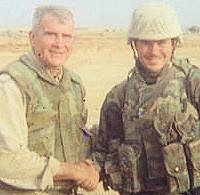 A proud parent's son / Marine, Mike Bancroft, shaking hands with Oliver North in Iraq during 2003.