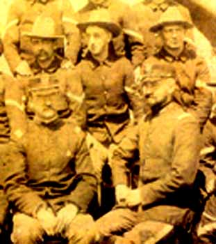 Michael Niland is top right above, sitting with Teddy Roosevelt, lower left, at San Juan Hill, almost half a century before D-Day.