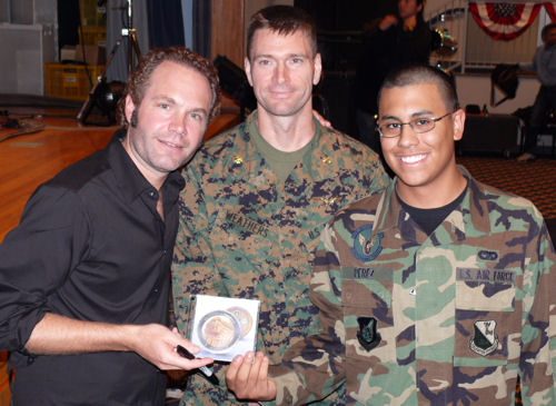 John Ondrasik with troops on USO tour holding his CD for the Troops (Photo by Dave Gatley)