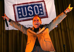 Rich Little impersonating President  Richard Nixon for the troops during USO tour in 2005.