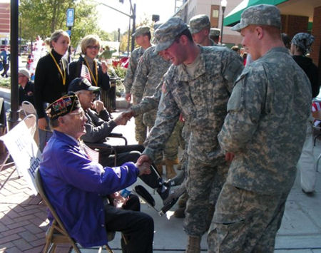 Troops shaking hands with veterans