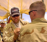 Toby Keith interacting with the troops