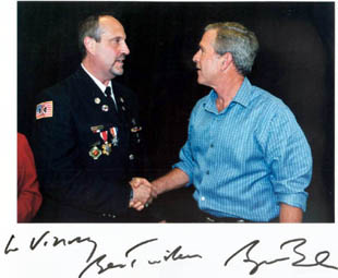 Vincent Forras shaking hands with President George W. Bush (related to 9/11/01)