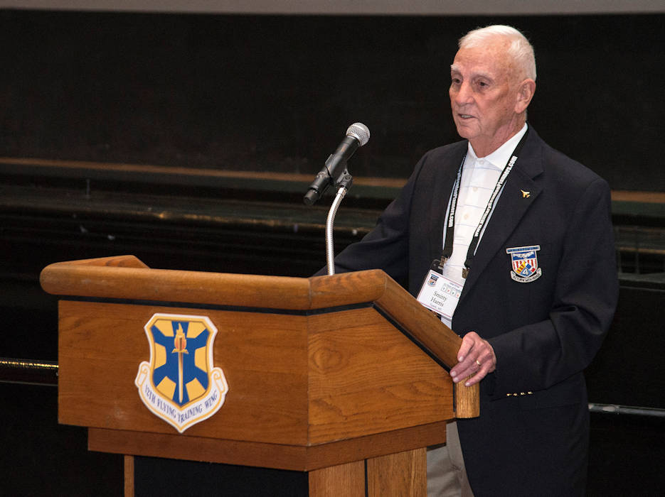 Retired Air Force Col. Carlyle Harris, former Vietnam War POW, speaks about his experiences in captivity on March 20, 2015 at the 18th Annual POW/MIA Symposium, hosted by the 560th Flying Training Squadron at the Joint Base San Antonio-Randolph Fleenor Auditorium. Harris was released Feb. 12, 1973, after being held for eight years. His aircraft was shot down by an anti-aircraft April 4, 1965, during a bombing run on the Ham Rong Bridge at Than Hoa. The annual Freedom Flyer Reunion tradition began when the 560th FTS was given the task to retrain more than 150 POWs returning to flying status toward the end of American involvement in the Vietnam War. (U.S. Air Force photo by Johnny Saldivar)