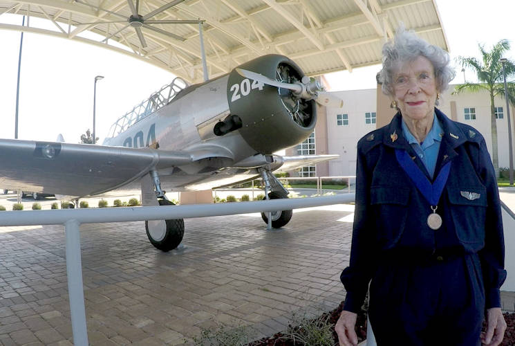 February 20, 2016 - Bernice Haydu, a Women Airforce Service Pilot, or WASP, during World War II, stands next to an AT-6 Texan at Page Field near Fort Myers, Florida. The WASPs flew Texans during flight training at Avenger Field in Sweetwater, Texas. (DoD photo by Navy Petty Officer 2nd Class Glenn Slaughter)