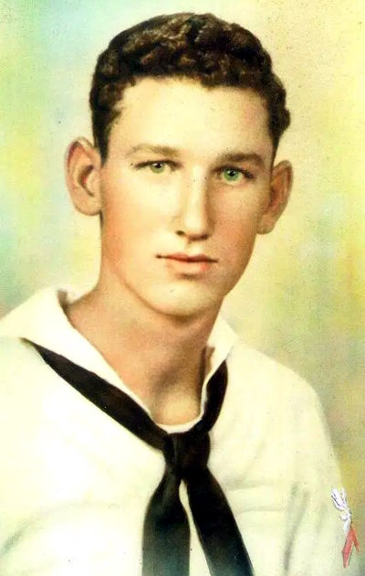 Colorized black and white photo from 1942, showing newly enlisted recruit Jim Evans in his dress whites. (Courtesy of the Evans Family)Colorized black and white photo from 1942, showing newly enlisted recruit Jim Evans in his dress whites. (Courtesy of the Evans Family)