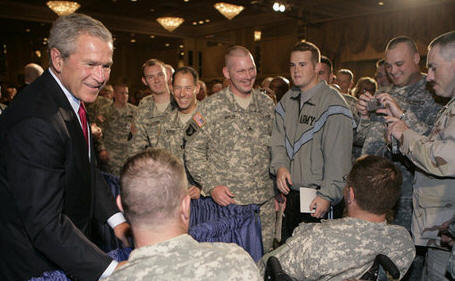 "President George W. Bush is greeted by military personnel following his address on the global war on terror at the Military Officers Association of America meeting Tuesday, Sept. 5, 2006, at the Capital Hilton Hotel in Washington. President Bush spoke about the U.S. and allies strategy for combating terrorism saying ""we're confronting them before they gain the capacity to inflict unspeakable damage on the world, and we're confronting their hateful ideology before it fully takes root."""