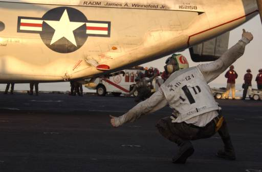 Aviation Machinist's Mate 3rd Class Christian Schlenker performs the final check before launching an E-2C Hawkeye aircraft during flight operations aboard USS Theodore Roosevelt (CVN 71) Jan. 2, 2006.