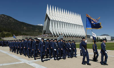USAFA noon meal formation with the Cadet Chapel and Rocky Mountains in the immediate background,  marching to Mitchell Hall.