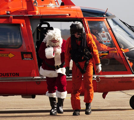 Santa Claus, played by U.S. Coast Guard Auxiliarist Gary Johnson, arrives at Coast Guard Air Station Houston, Texas, Dec. 8, 2007, to visit Coast Guard families. Santa arrived by HH-65C Dolphin helicopter to hand out presents.